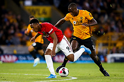 Raul Jimenez of Wolverhampton Wanderers takes on Willy Boly of Wolverhampton Wanderers - Mandatory by-line: Robbie Stephenson/JMP - 19/08/2019 - FOOTBALL - Molineux - Wolverhampton, England - Wolverhampton Wanderers v Manchester United - Premier League