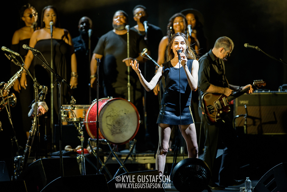 VIENNA, VA - July 21st, 2017 - PJ Harvey (center) performs with Anacostia's Union Temple Baptist Church Choir at the Filene Center at Wolf Trap in Vienna, VA. A trip to Washington, D.C. in 2016 inspired much of Harvey's latest album, The Hope Six Demolition Project. (Photo by Kyle Gustafson / For The Washington Post)