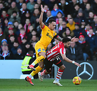 Lincoln City's Bruno Andrade is fouled by Northampton Town's Shay Facey<br /> <br /> Photographer Andrew Vaughan/CameraSport<br /> <br /> The EFL Sky Bet League Two - Lincoln City v Northampton Town - Saturday 9th February 2019 - Sincil Bank - Lincoln<br /> <br /> World Copyright © 2019 CameraSport. All rights reserved. 43 Linden Ave. Countesthorpe. Leicester. England. LE8 5PG - Tel: +44 (0) 116 277 4147 - admin@camerasport.com - www.camerasport.com