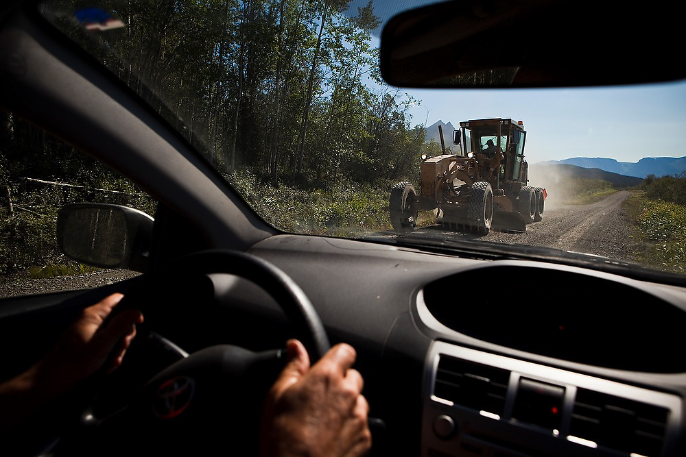 Parmenter Welty drives past heavy road grading machinery on the McCarthy road into Wrangell-St. Elias National Park, Alaska.