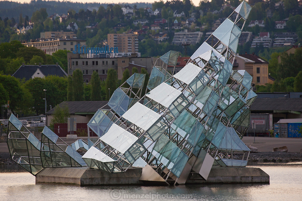 Glass and steel art on a floating island in the harbor by the Opera House, Den Norske Opera and Ballett, Oslo, Norway.