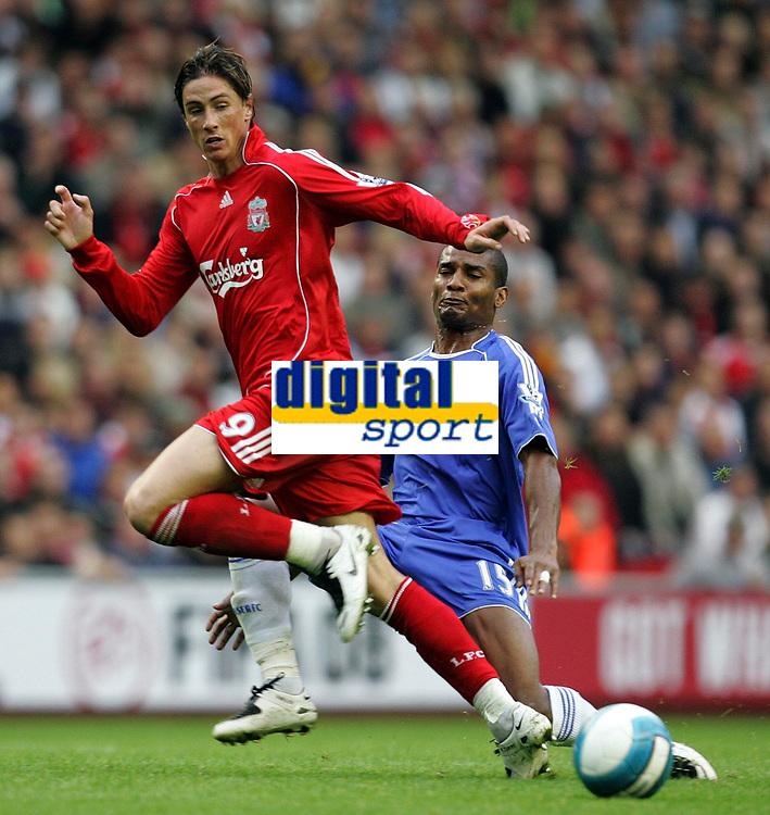Photo: Paul Thomas.<br /> Liverpool v Chelsea. The FA Barclays Premiership. 19/08/2007.<br /> <br /> Goal scorer Fernando Torres (L) of Liverpool battles Florence Malouda.