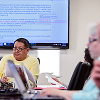 042314       Cable Hoover<br /> <br /> Board chairman Edwin Begay and other advisory board members review their operating agreement during a meeting at UNM-Gallup Wednesday.