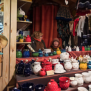 BUDAPEST, HUNGARY - DECEMBER 07:  Stall holders wait for customer at the  Vorosmarty Square Christmas market on December 7, 2017 in Budapest, Hungary. The traditional Christmas market and lights will stay until 31st December 2017.