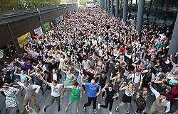 © Licensed to London News Pictures. 11/10/2015. London, UK. Volunteers attempt to break the world record for the largest number of people dancing the Charleston at Spitalfields. Photo credit: Peter Macdiarmid/LNP