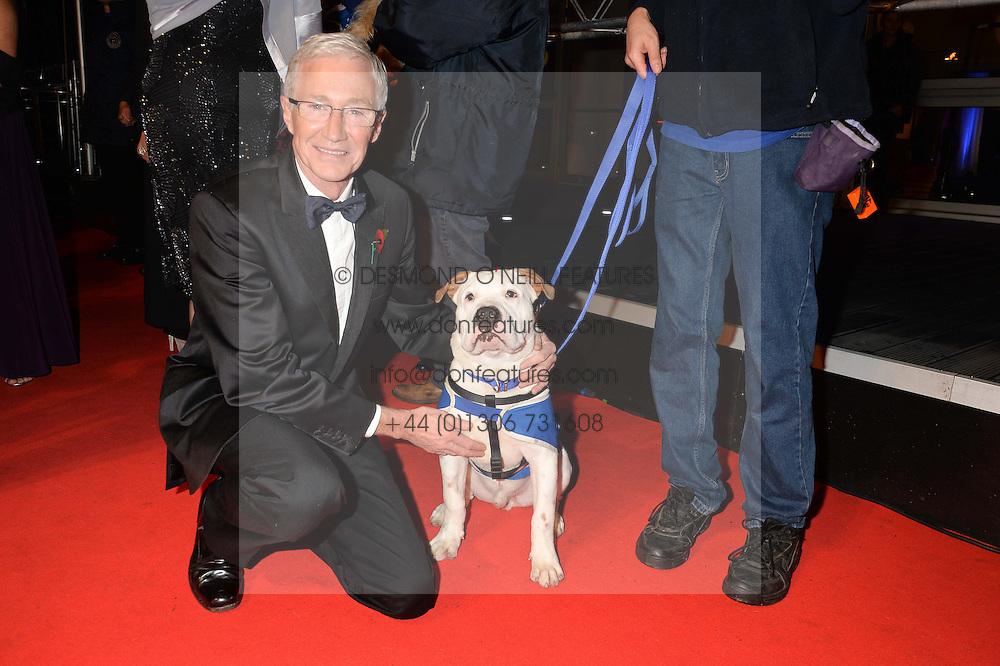 PAUL O'GRADY and Battersea dog Basil at Battersea Dogs & Cats Home's Collars & Coats Gala Ball held at Battersea Evolution, Battersea Park, London on30th October 2014.