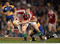 11 June 2013; Brian O'Driscoll, British & Irish Lions, is tackled by Shaun McCarthy, Combined Country. British & Irish Lions Tour 2013, Combined Country v British & Irish Lions, Hunter Stadium, Newcastle, NSW, Australia. Picture credit: Stephen McCarthy / SPORTSFILE