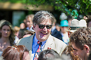 Stephen Fry talks to Rowan Atkinson on the No Man's Land:ABF The Soldier's Charity Garden. The Chelsea Flower Show 2014. The Royal Hospital, Chelsea, London, UK.