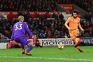 Mohamed Salah of Liverpool (r) puts the ball past Stoke City Goalkeeper Lee Grant to score his teams 3rd goal. Premier league match, Stoke City v Liverpool at the Bet365 Stadium in Stoke on Trent, Staffs on Wednesday 29th November 2017.<br /> pic by Chris Stading, Andrew Orchard sports photography.