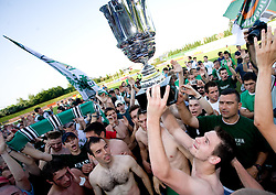 Agim Ibraimi, Adnan Alagic, Davor Bubanja and Alen Sculac at award ceremony celebrate with the Cup after final match of 2nd SNL league between NK Olimpija in NK Aluminij, on May 23, 2009, ZAK, Ljubljana, Slovenia. Aluminij won 2:1. NK Olimpija is a Champion of 2nd SNL and thus qualified to 1st Slovenian football league for season 2009/2010. (Photo by Vid Ponikvar / Sportida)