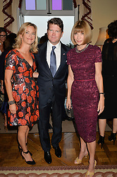 Left to right, BROOKE BARZUN, MATTHEW BARZUN and ANNA WINTOUR at a party hosed by the US Ambassador to the UK Matthew Barzun, his wife Brooke Barzun and editor of UK Vogue Alexandra Shulman in association with J Crew to celebrate London Fashion Week held at Winfield House, Regent's Park, London on 16th September 2014.