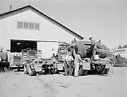 """ackroyd 04645-207. """"Van Vleet Logging. Cannon Beach. September 17, 1953"""" Industrial building with """"Cannon Beach ... Lumber"""" sign. Location is on southeast corner of what used to be Division St., now called East Gower Avenue, At Hemlock. This site is now the  Haystack Rock Public Parking Lot, on South Hemlock between Gower and Coolidge avenues. This building was essentially inbetween what is now the Cannon Beach Hotel and Cannon Beach City Hall buildings. September 17, 1953"""