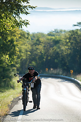 Alex Trepanier of California pushes his 1913 Indian up a steep grade during the Motorcycle Cannonball Race of the Century. Stage-4 from Chillicothe, OH to Bloomington, IN. USA. Tuesday September 13, 2016. Photography ©2016 Michael Lichter.