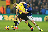 Gareth Barry of Everton challenges Nordin Amrabat of Watford. Premier league match, Watford v Everton at Vicarage Road in Watford, London on Saturday 10th December 2016.<br /> pic by John Patrick Fletcher, Andrew Orchard sports photography.