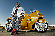 Tommy Bolton in front of a custom Suzuki Hayabusa that he built.
