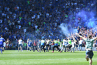 Football - 2017 / 2018 Sky Bet Championship - Cardiff City vs. Reading<br /> <br /> Cardiff fans invade the pitch before the end of the game, smoke from fireworks in background , at Cardiff City Stadium.<br /> <br /> COLORSPORT/WINSTON BYNORTH