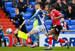 Oldham Athletic's Mat Sadler is closed down by Bristol City's Kieran Agard - Photo mandatory by-line: Matt McNulty/JMP - Mobile: 07966 386802 - 03/04/2015 - SPORT - Football - Oldham - Boundary Park - Oldham Athletic v Bristol City - Sky Bet League One