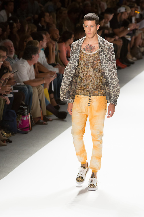 Men's print pants with eleastic cuffed hems, print top, and print jacket. By Custo Barcelona at the Spring 2013 Fashion Week show in New York.