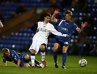 Photo: Rich Eaton.<br /> <br /> Peterborough United v Swansea City. Johnstone's Paint Trophy. 31/10/2006. Chris Jones centre of Swansea finds his path blocked by Jamie Day left and Jamie Day right of Boro