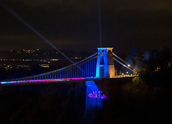 © Licensed to London News Pictures; 22/10/2021; Bristol, UK. 'Light the Night' bridge illuminations at Clifton Suspension Bridge. The bridge is illuminated in blue, a colour chosen in a vote by the sponsors of the Light the Night campaign, along with other colours. In Autumn 2020, the Museums Association and Crowdfunder UK ran a fundraising project called #SupportOurMuseums to bring much needed funds to museum and heritage attractions forced to close by the covid coronavirus pandemic lockdowns. As part of #SupportOurMuseums, Clifton Suspension Bridge Visitor Centre launched the 'Light the Night' campaign to 'spread a smile across Bristol' with funds raised to support the educational work of the Visitor Centre, and to create a special evening of bridge illuminations. The illuminations are switched on at 7.30pm, with the button pressed by Natalie Thomas representing Faster Britain, who chose this reward during the<br /> Crowdfunder campaign, to support the Clifton Suspension Bridge during lockdown. Photo credit: Simon Chapman/LNP.