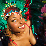 The setting sun hits a peformer as she dance and whine her way in the parade. The Notting Hill Carnival has been running since 1966 and is every year attended by up to a million people. The carnival is a mix of amazing dance parades and street parties with a distinct Caribbean feel.