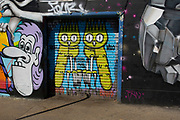 Street art owls by Dscreet in Hackney Wick, East London, United Kingdom. Street art in the East End of London is an ever changing visual enigma, as the artworks constantly change, as councils clean some walls or new works go up in place of others. While some consider this vandalism or graffiti, these artworks are very popular among local people and visitors alike, as a sense of poignancy remains in the work, many of which have subtle messages.