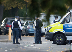 © Licensed to London News Pictures. 22/10/2016. London, UK. Police cordon off a road in Northolt. Police attended an address in Wood End Lane, Northolt at shortly after 00:50hrs on Friday, 21 October after a report of concerns for the occupant and hazardous items inside the property. Police believe a man is still inside the house. Photo credit: Ben Cawthra/LNP