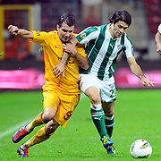Galatasaray's Engin BAYTAR (L) and Bursaspor's Adem KOCAK (R) during their Turkish Super League soccer match Galatasaray between Bursaspor at the TT Arena at Seyrantepe in Istanbul Turkey on Sunday 16 October 2011. Photo by TURKPIX