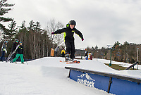 Gavin Makely gets some air time on the rails and boxes set at Gunstock Mountain with the Gunstock Freestyle Academy on Sunday morning.  (Karen Bobotas/for the Laconia Daily Sun)