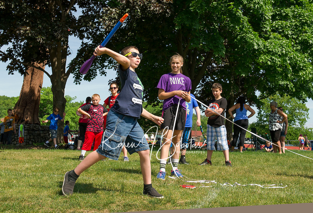 Julian Walton of WHES throws the javelin during the 5th Grade Track Meet at Opechee Wednesday morning.  (Karen Bobotas/for the Laconia Daily Sun)