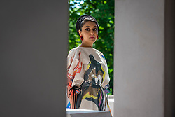 © Licensed to London News Pictures. 08/06/2021. LONDON, UK. Architect Sumayya Vally poses at the unveiling of the 20th Serpentine Pavilion in Kensington Gardens. It is designed by Johannesburg-based practice Counterspace and directed by Vally, who is the youngest architect to be commissioned for this internationally renowned architecture programme.  The design references the architecture in migrant communities in some of London's neighbourhoods and is on display 11 June to 17 October.  Photo credit: Stephen Chung/LNP