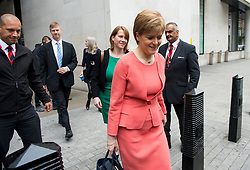 © Licensed to London News Pictures. FILE PICTURE: 14/07/2015. London, UK. Leader of the SNP and First Minister of Scotland, NICOLA STURGEON leaving BBC Broadcast House in London with her aide LIZ LLOYD (pictured rear) after appearing on the Today programme on Radio 4. There are claims that Sturgeon's top political aide in government knew about the civil service probe into Alex Salmond months before the First Minister claims she found out. Photo credit: Ben Cawthra/LNP