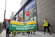Members of the PCS trade union working for the outsourced contractor ISS march around their workplace at the Department for Business, Energy and Industrial Strategy BEIS on the second day of a 3-day strike on 20th July 2021 in London, United Kingdom. The striking cleaners, security guards and other support staff at the government department are demanding an end to low pay, improved working conditions, bonuses for having worked through lockdown, annual leave from last year and a Covid return-to-work protocol.