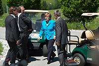 07 JUN 2015, ELMAU/GERMANY:<br /> Angela Merkel (M), CDU, Bundeskanzlerin, und Ihr Ehemann Joachim Sauer (R), steigen auf dem Weg zur Begruessung der anderen Gipfelteilnehmer aus einem Golfwagen, G7-Gipfels vor Schloss Elmau bei Garmisch-Patenkirchen<br /> IMAGE: 20150607-01-005<br /> KEYWORDS: G7 Summit