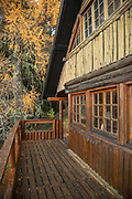 View of outside of Berghof Lodge in autumnal forest in Bariloche, Argentina