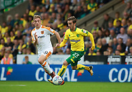 Norwich City's James Maddison and Hull City's Jarrod Bowen during the EFL Sky Bet Championship match between Norwich City and Hull City at Carrow Road, Norwich, England on 14 October 2017. Photo by John Marsh.