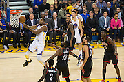 Golden State Warriors forward Kevin Durant (35) takes the ball to the basket against the Houston Rockets at Oracle Arena in Oakland, Calif., on December 1, 2016. (Stan Olszewski/Special to S.F. Examiner)