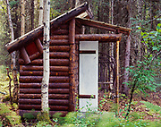 Log Outhouse built by Jerry Conrad at Coyote Gardens, Willow, Alaska.