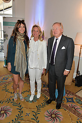 Left to right, LOHRALEE ASTOR and LORD & LADY BAMFORD at a breakfast hosted by Zita West and Leo Bamford to launch a range of vitamins for babies & children held at the Royal Society of Medicine, Chandos House, 2 Queen Anne Street, London on 21st May 2015.
