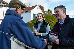 © Licensed to London News Pictures. 18/11/2019. RICKMANSWORTH, UK.  Former Justice Secretary David Gauke (R) campaigns in Rickmansworth as an independent candidate to be the MP of South West Hertfordshire, the seat he has held since 2005.  Offering support to him on the general election campaign trail is former Home Secretary Amber Rudd (C), who has announced she will not be standing as an MP. The pair speak to local resident Jasim Ahmed (L). Photo credit: Stephen Chung/LNP