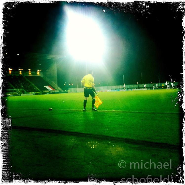 Linesman, Falkirk stadium..Hipstamatic images taken on an Apple iPhone..©Michael Schofield.