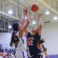 020315       Cable Hoover<br /> <br /> Gallup Bengal Cheyenne Livingston (32) grabs a rebound away from Miyamura Patriot Amanda Paywa (23) Tuesday at Miyamura High School.