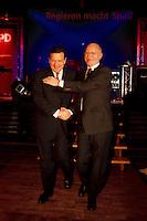 """03.12.1998, Deutschland/Bonn:<br /> Gerhard Schröder, SPD, Bundeskanzler, und Peter Struck, SPD Fraktionsvorsitzender, nach Schröders Rede, Festveranstaltung der SPD Bundestagsfraktion """"Regieren macht Spaß"""", Stadthalle, Bonn-Bad Godesberg<br /> IMAGE: 19981203-02/02-26<br />  <br />           <br /> KEYWORDS: Gerhard Schroeder"""