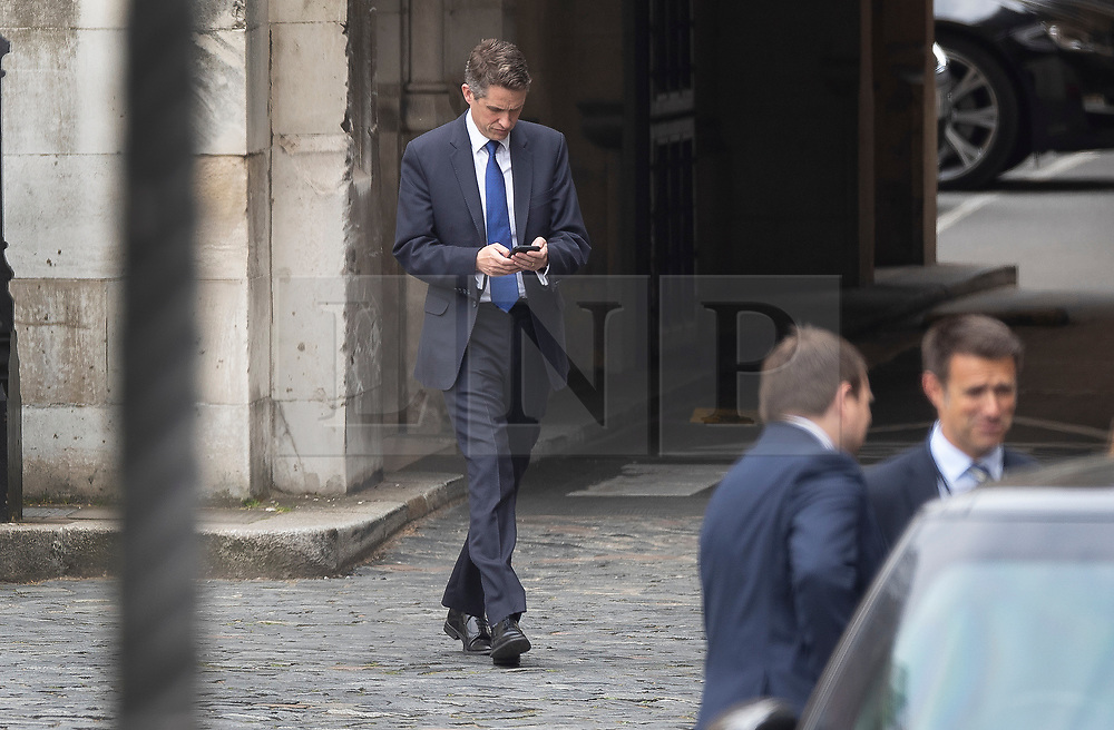 © Licensed to London News Pictures. 01/05/2019. London, UK. Defence Secretary Gavin Williamson is seen looking at his mobile phone in New Palace Yard at Parliament before it was announced that he has been sacked in connection with the leaking of information from the National Security Council meeting discussing Huawei's limited access to help build the UK's new 5G network. Photo credit: Peter Macdiarmid/LNP