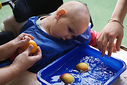 Disabled children in supportive equipment,