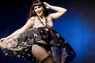 Sexy girl in vintage lingerie caught by a playful breeze