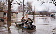 30 DEC. 2015 -- HIGH RIDGE, Mo. -- Residents launch a boat to go check on a residence in the Riverbend Mobile Home Park, flooded by waters from the nearby Big River, near High Ridge, Missouri USA Wednesday 30 December 2015. Historic rainfall across the American Midwest have pushed the Meramec and Big rivers in Missouri, tributaries to the Mississippi River, to record levels. Photo © copyright 2015 Sid Hastings.