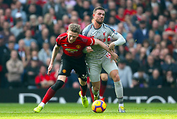 Manchester United's Scott McTominay (left) and Liverpool's Jordan Henderson battle for the ball