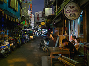 15 OCTOBER 2016 - BANGKOK, THAILAND: Darkened and closed go-go bars on Soi Cowboy in Bangkok. Thailand's infamous nightlife has been cancelled out of respect for the late Bhumibol Adulyadej, the King of Thailand. King Bhumibol Adulyadej died Oct. 13, 2016. He was 88. His death comes after a period of failing health. With the king's death, the world's longest-reigning monarch is Queen Elizabeth II, who ascended to the British throne in 1952. Bhumibol Adulyadej, was born in Cambridge, MA, on 5 December 1927. He was the ninth monarch of Thailand from the Chakri Dynasty and is known as Rama IX. He became King on June 9, 1946 and served as King of Thailand for 70 years, 126 days. He was, at the time of his death, the world's longest-serving head of state and the longest-reigning monarch in Thai history.      PHOTO BY JACK KURTZ