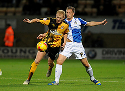 Lee Mansell of Bristol Rovers challenges Robbie Simpson of Cambridge United - Mandatory byline: Neil Brookman/JMP - 07966 386802 - 30/10/2015 - FOOTBALL - The Abbey Stadium - Cambridge, England - Cambridge United v Bristol Rovers - Sky Bet League Two